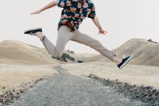 Man jumping for joy because of bonus $25 on GMAT